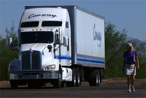 image: Con-way freight delivery women truck driver less than truckload