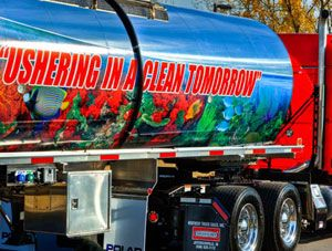 image: US road haulage freight logistics inflammable liquid tank truck driver hazardous liquid