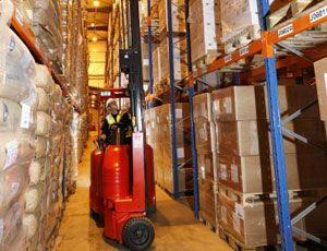 image: UK articulated fork lift supply chain flexi truck freight storage warehouse narrow aisle