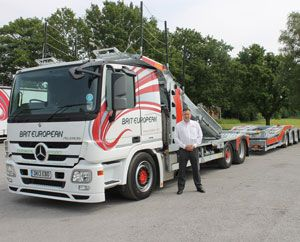 image: UK road haulage HGV low carbon emission dual fuel logistics