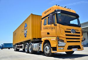 image: China Suning logistics freight road haulage autonomous truck AI warehouse fleet Strolling Dragon