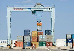 image: Spain RTG crane port container handling Valencia Konecranes TCV rubber tyred gantry tonnes TEU
