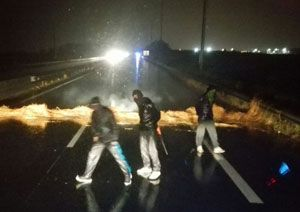 image: UK France road haulage freight transport Calais ferry port migrants jungle chainsaw attack death