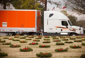 image: Con-way Schneider trucking road haulage freight patriot award veterans