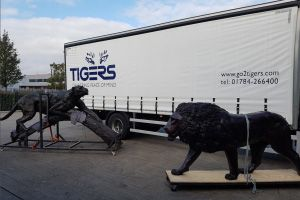 image: UK South Africa supply chain logistics Tigers lions leopards shipping Artist Bruce Little