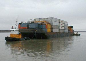 image: UK logistics freight forwarding container shipping water