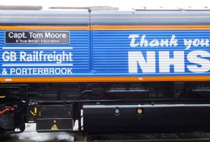 image: UK Colonel captain Tom Moore veteran NHS railway GB Railfreight locomotive naming