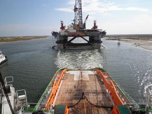 image: Netherlands heavy lift logistics freight tug semi submersible rig offshore energy