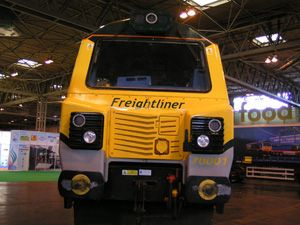 image: UK France rail freight tonnes cargo logistics road haulage truck shipping container box