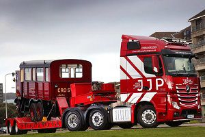 image: UK JJP Heavy Haulage road operator heritage buses trucks Mercedes steam locomotive