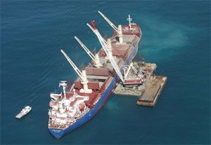 image: US Australia shipwrecks container shipping bulk carrier cargo barges salvage