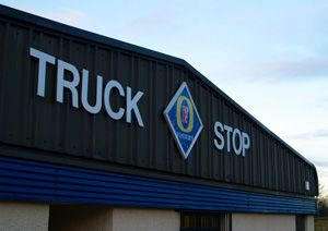 image: UK US truck stop freight road haulage tachograph driver hours of service