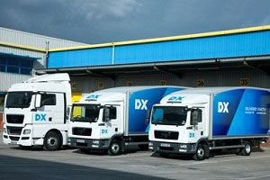 image: DX Group John Menzies Gatemore logistics freight merger million pound financing parcel DHL Royal Mail