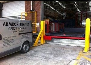 image: Armkor cargo handling freight supply chain materials truck dock scissor lift