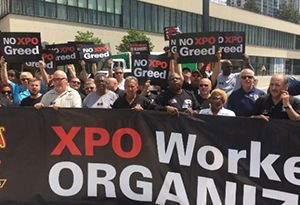 image: US supply chain summit Teamsters XPO logistics freight protest Bradley Jacobs