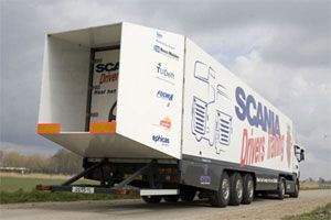 image: Scania FOCWA  TU Delft TNT European Truck Testbed Fuel Savings  operators fleet emissions boat tail  roof fairings tractor side panels air dam