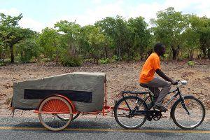 image: Zambia Transaid ambulance warehouse distribution child malaria supply chain sick children