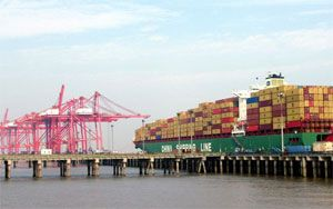 image: China US container shipping freight terminal traffic no frills TEU boxes ships