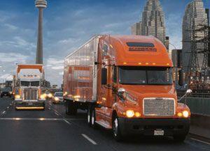 image: Schneider National Canadian intermodal truckload rail freight logistics multimodal KCS