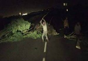 image: UK France road haulage trucks assault attack Calais boulder thrown migrants