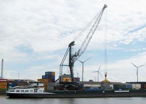 image: Netherlands Pacorini Metals Liebherr mobile harbour crane shipping container bulk freight