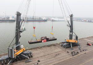image: Belgium France Liebherr mobile harbour crane logistics port vessel break bulk cargo