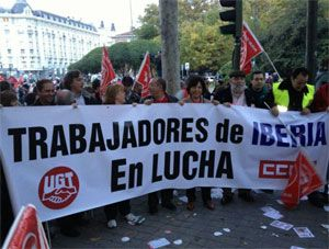image: US Spain UK transport unions dock workers loading strike lock out
