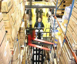 image: UK fork truck freight handling warehouse Flexi racking cargo man-up