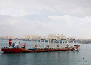 image: Jebel Ali UAE Dubai DP World container shipping port terminal crane rail mounted gantry RMG Zhenhua Heavy Industries ZPMC