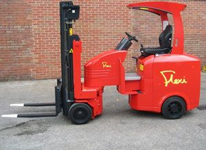 image: UK Flexi freight logistics articulated forklift truck narrow aisle racking