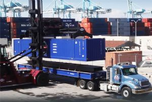 image: UK, US, container, logistics, supply chain, freight, multimodal, awards, Kevin Keegan, ports, ship to shore, cranes, Liebherr, Peel, XPO, CakeBoxx,