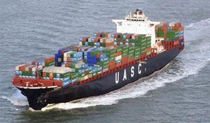 image: Khorfakkan Freight Container Terminal Liebherr Sharjah United Arab Shipping Company quay port shipping gantries Momentum Logistics Gulftainer