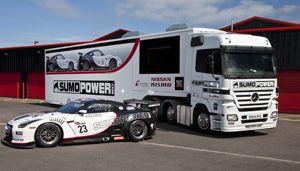 image: UK Mercedes freight truck Nissan GTR
