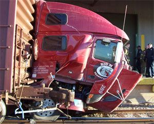 image: US freight truck rail crossing accident loading dock