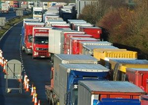 image: England tunnel channel ferry freight rail trucks