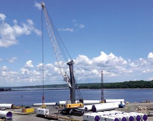 image: US cargo crane freight handling harbour containers heavy lift project