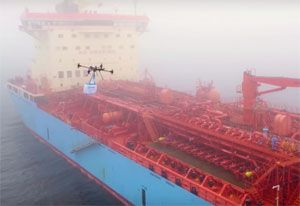 image: Maersk drone express freight delivery cookies ship at sea logistics