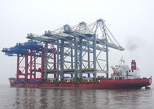 image: London Eye Gateway DP World container shipping freight quay crane box port China UK deep water vessels
