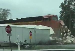 image: US freight train sweet semi-truck HGVs driver citation railroad crossing Locust Grove road haulage satellite navigation