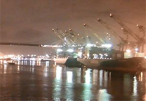 image: US west coast port Oakland cargo ship container freight longshoremen vessel PMA ILWU chassis trailer box