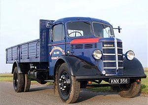 image: UK road haulage freight truck maintenance vintage Bedford trailer sheet