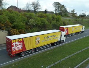 image: UK logistics longer road haulage trailers freight trucks environmental damage more axles heavier tonnage