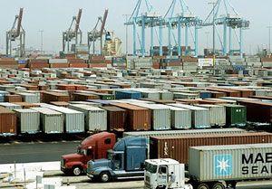 image: US west coast ILWU PMA vessel working slow down wages ports