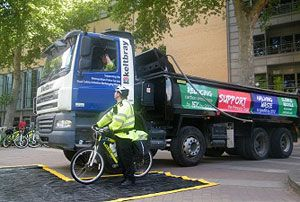 image: UK freight transport truck lorries road haulage cyclist safety