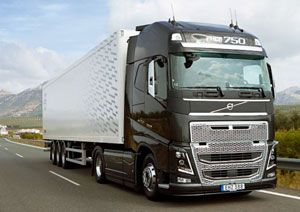 image: US Volvo road haulage truck save fuel avoid collisions convoy Peloton