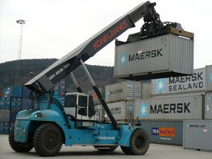 image: UK freight port equipment reach truck sideloader gantry crane