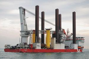 image: Hartlepool UK container shipping freight vessel logistics wind turbine LNG tanker