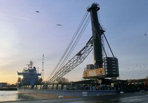 image: Netherlands mobile harbour crane Liebherr straddle carrier bulk freight container handling
