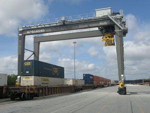 image: Konecranes CSX rubber tyred gantry RTG crane reach stacker export container handling bulk cargo terminal multimodal