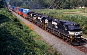image: US rail freight cars shipping trucking trucks inter modal